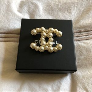 Authentic Chanel pearl brooch.